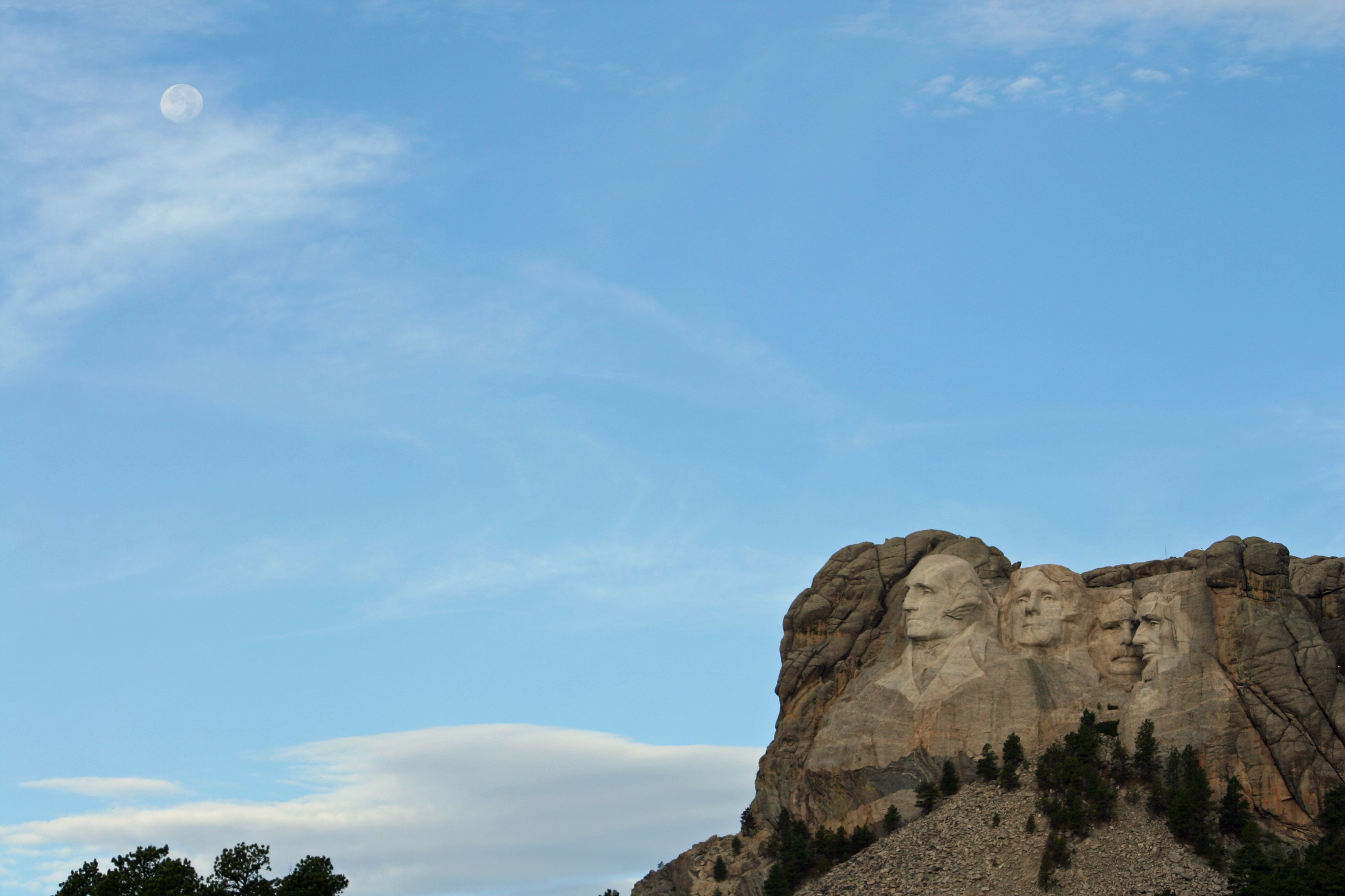 I was headed to Iron Mountain Road to make the drive between Rushmore and Custer,  early in the morning.  The sun had just risen, and the moon was still out.  (Mt. Rushmore, SD)