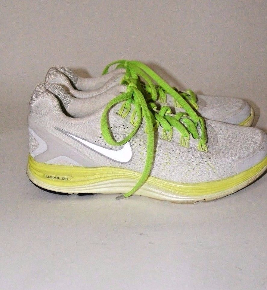 0150606d0742 Lunarglide 4. Nike Lunarlon Sneakers. White with Yellow Green Accents.  Length - 10.25