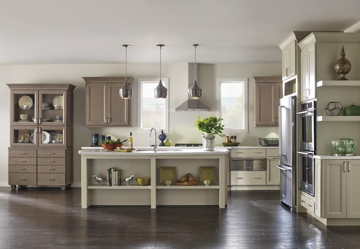 Space in the kitchen by adding shelves and glass canisters with seals - Complementary Finishes On These Maple Kitchen Cabinets Create An Open Casual Space With The Flexibility To Bring In A Variety Of Colors And Textures