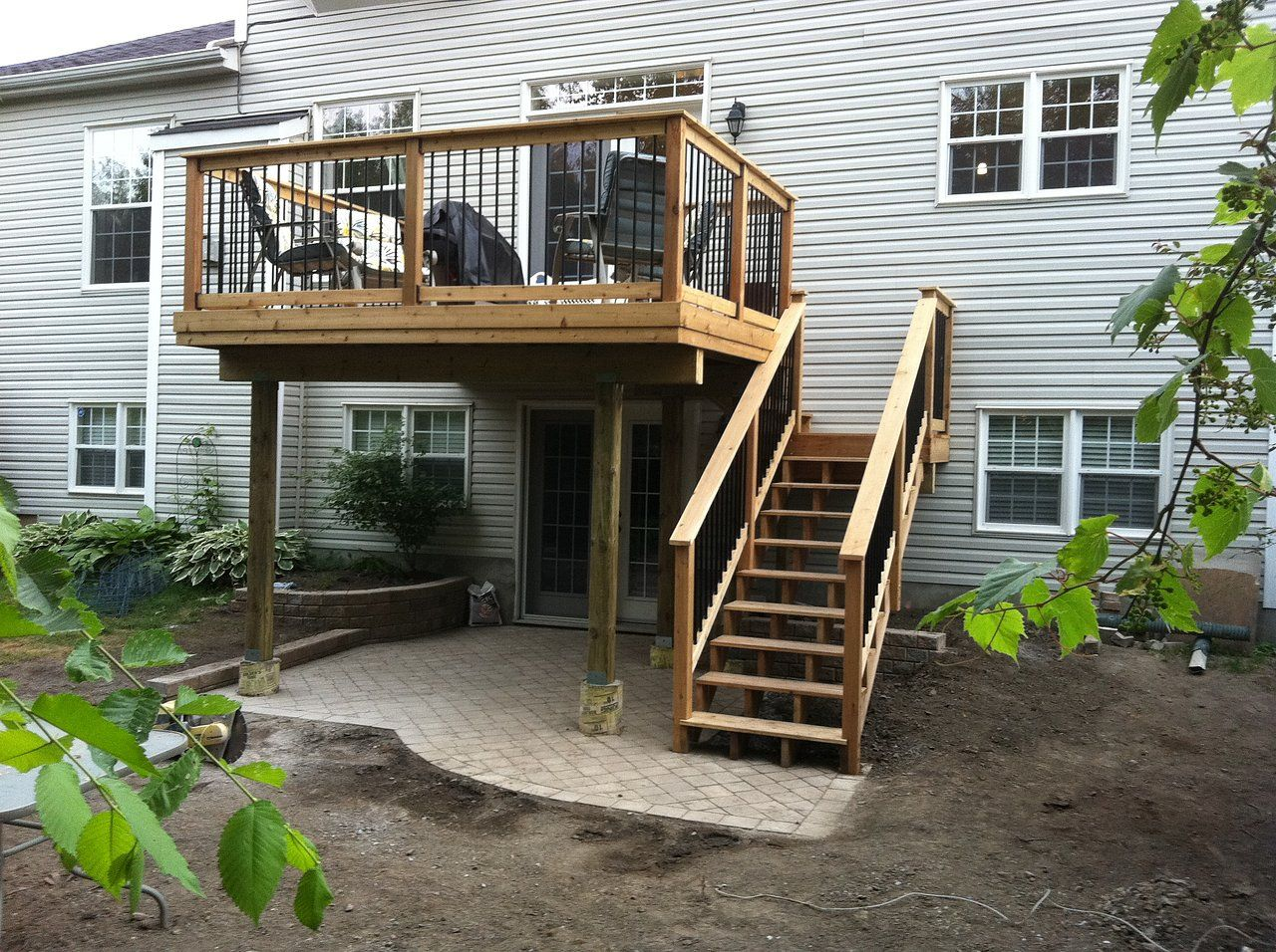 Two story decks with stairs ottawa hoyle contracting for Split level garden decking