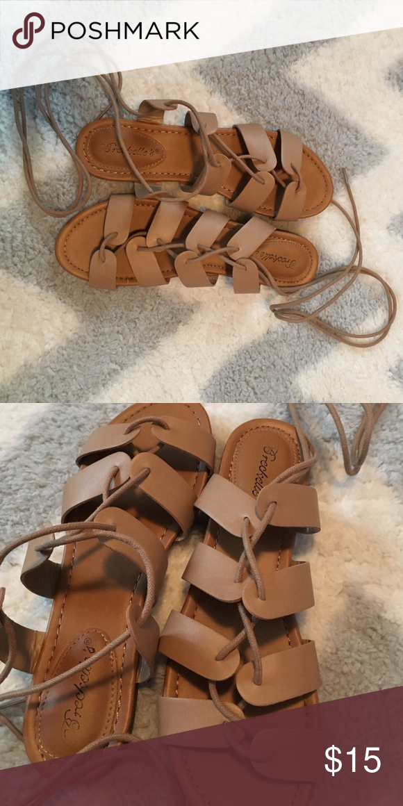 Strappy sandals Strappy nude sandals with laces that can go around ankle. Only worn twice Breckelles Shoes Sandals