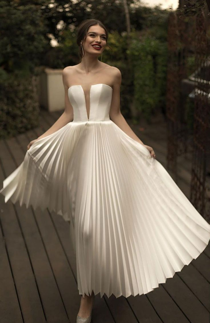 Photo of A striking modern statement and glamorous wedding dresses in minimalist …
