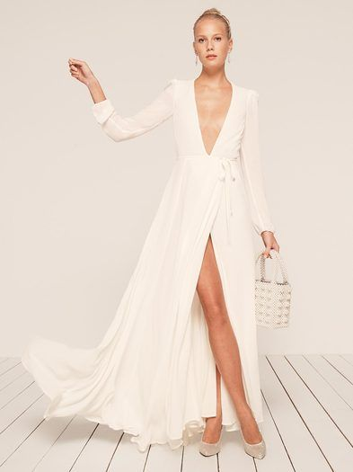 Finally you don't have to lie about liking your bridesmaid dress. This is a floor length, wrap dress with a very deep v neckline and long sleeves.