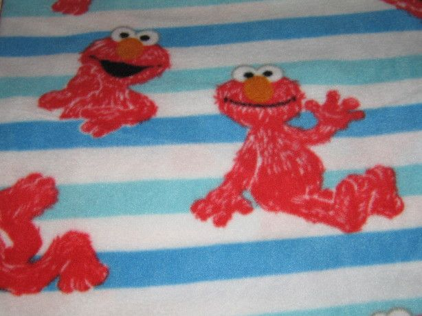 kids love this elmo all over with blue stripes blanket at nap time with this Elmo Blanket and pillow set. Perfect for nap mates or elmo room for your favorite toddler.IMG_3467