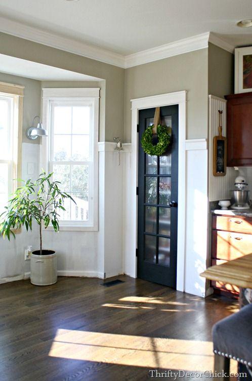 Adding White Board And Batten Around A Black Pantry Door.