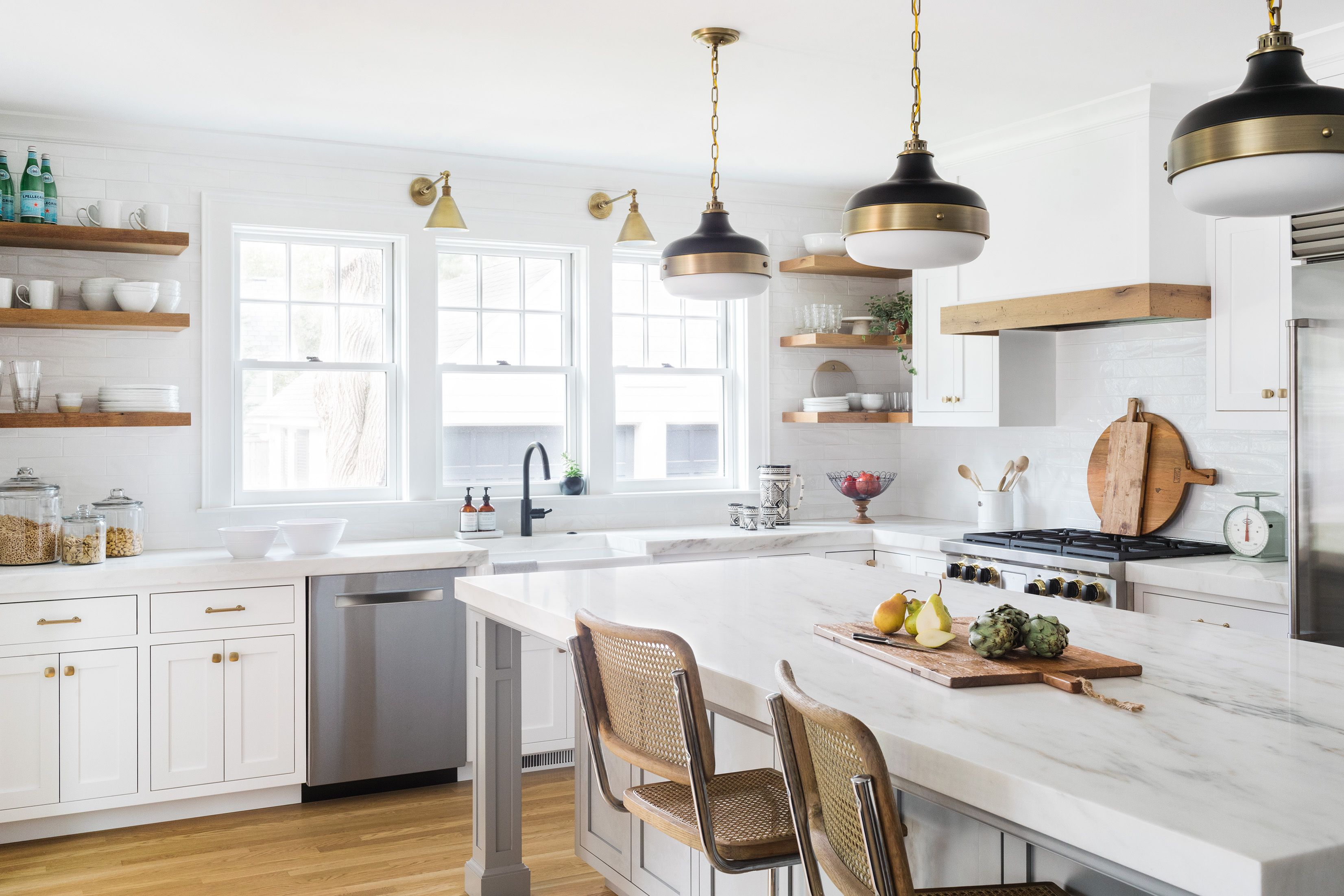An updated kitchen with luxe finishes, plenty of pantry storage, and ...