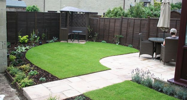 The new and simple garden town layout with patio, sunny lawn, flower beds  and