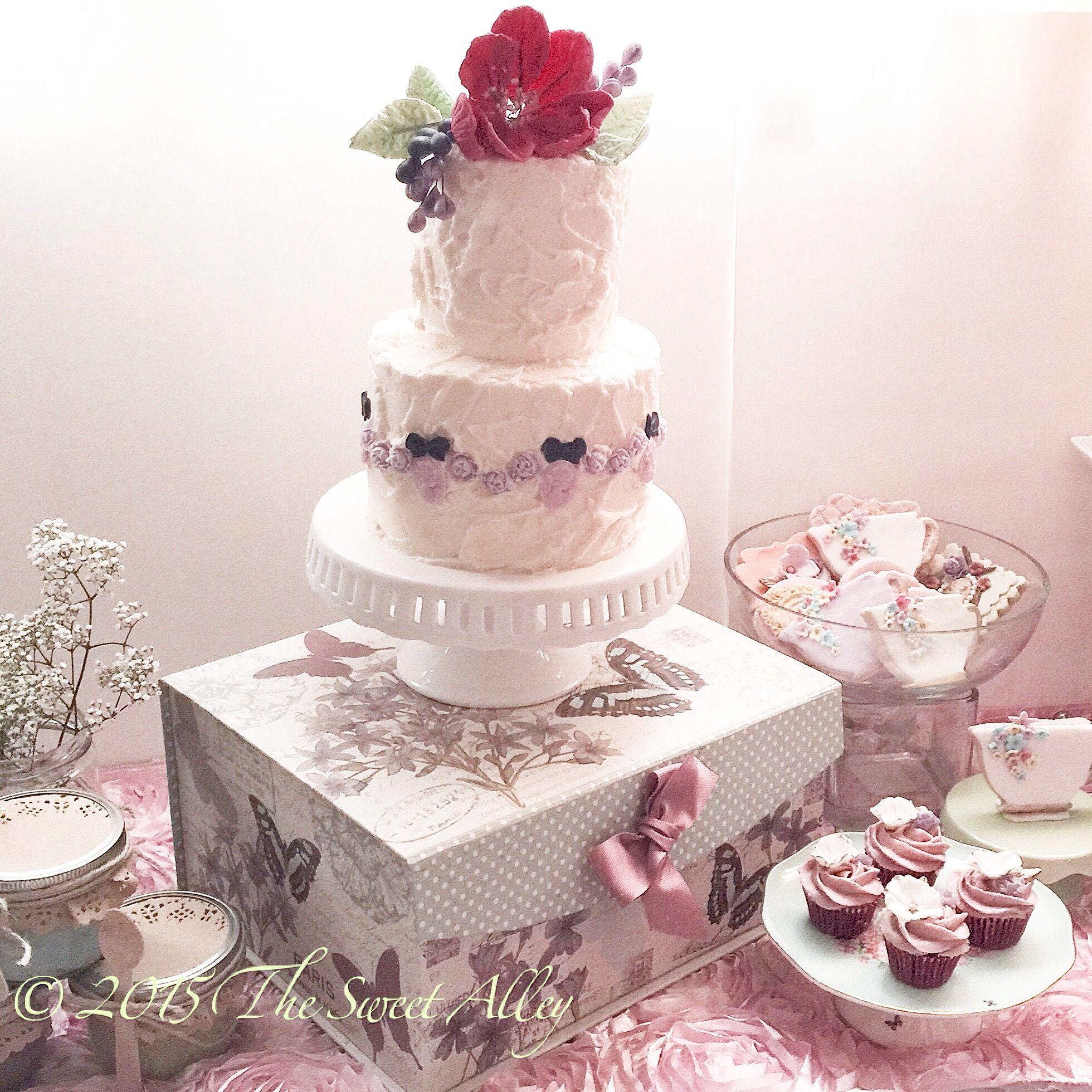 Vintagethemed dessert table for a bridal showertea party