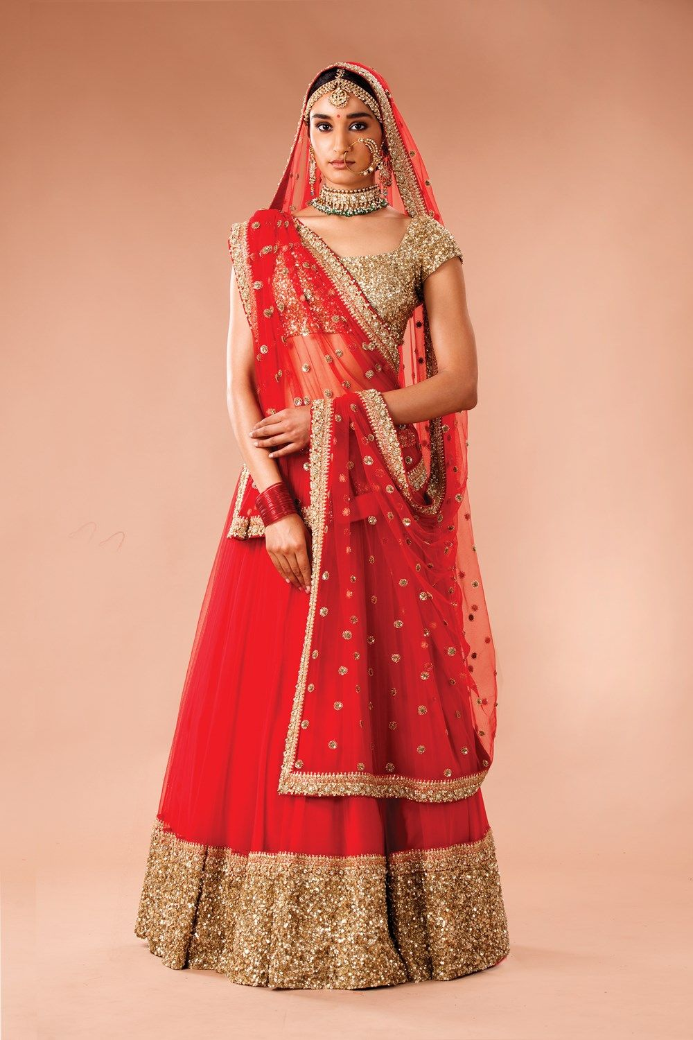 812ba85fe341e Red tulle and silk lehenga with sequin and zardozi detail by Sabyasachi