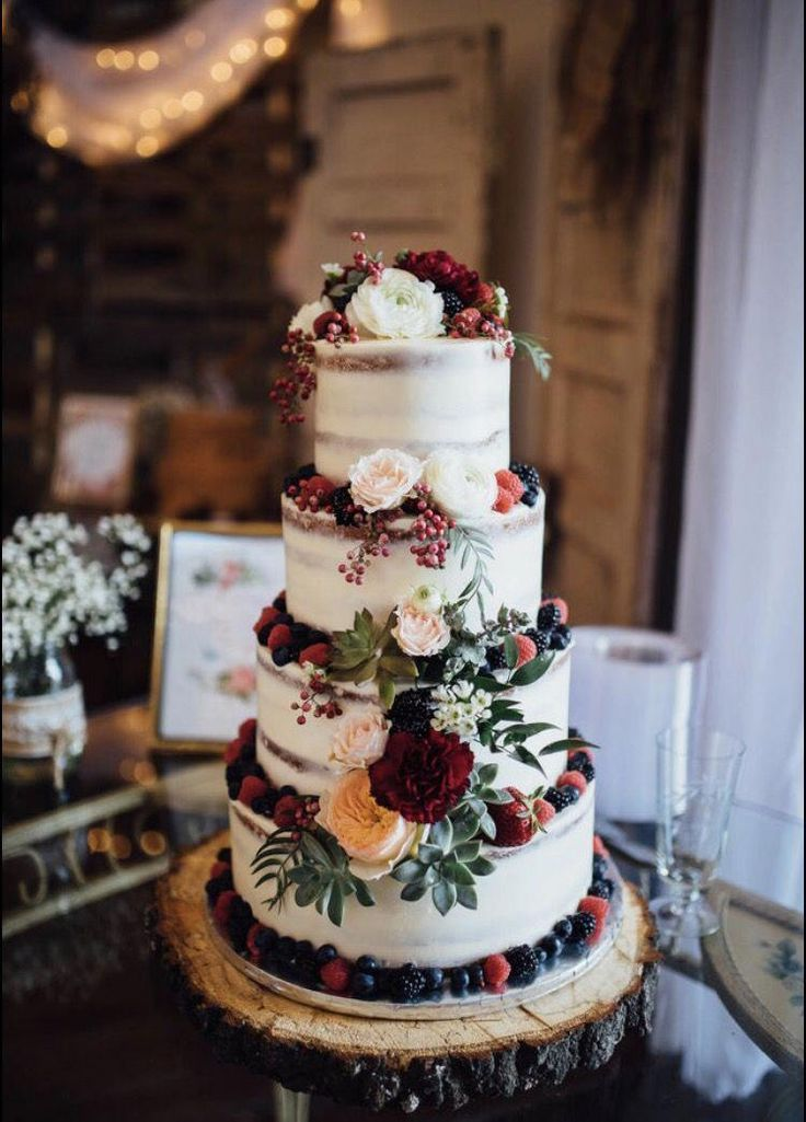 Burgundy and white naked wedding cake. greenery
