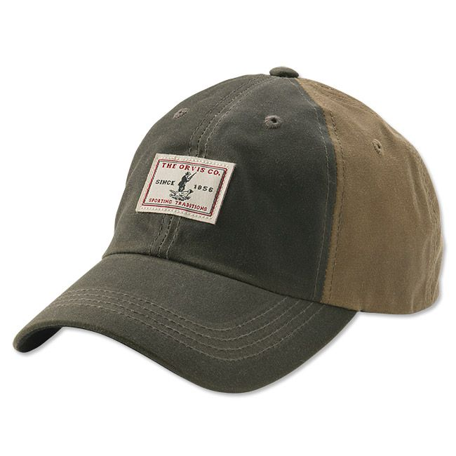 This two-tone waxed cotton cap brings the best of classic tradition while… af6988b100fb