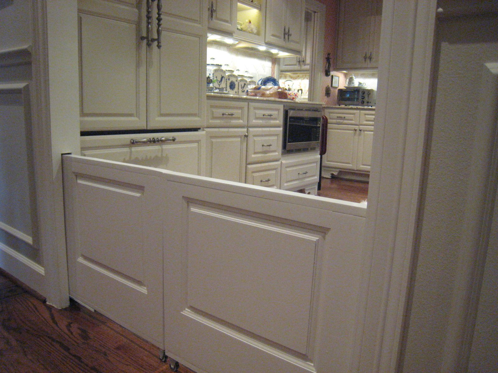 Kitchen cabinets pocket doors - If You Are Building An New Home Slide Out Dog Kid Doors This Is The Greatest Idea Ever No More Awful Looking Baby Gates Pocket Door Baby Gates If Only