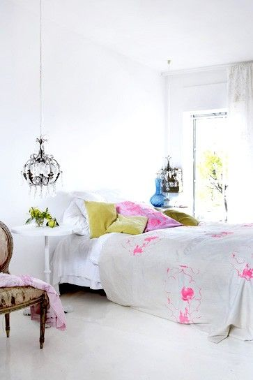 white bedroom with colour accents