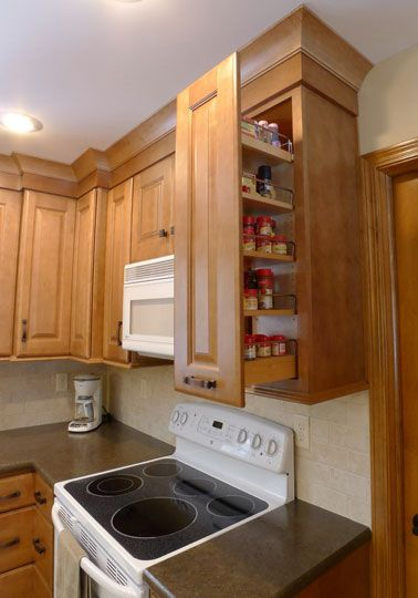 starmark cabinetry slide out pantry in a wall cabinet kitchen