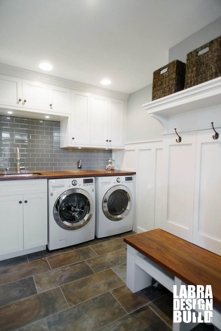 Custom Mudroom And Laundry Room Combo With White Cabinetry And