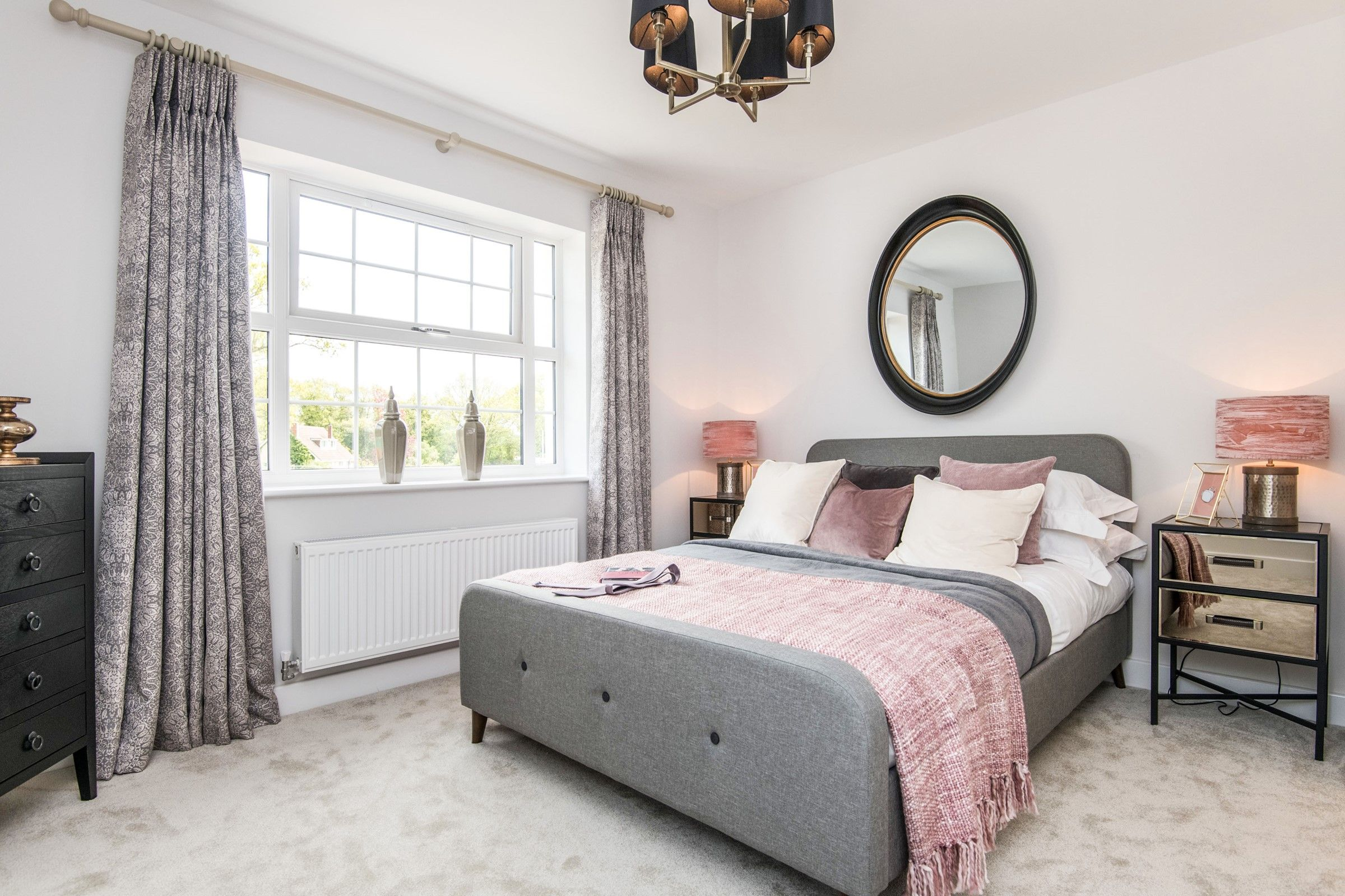 Blush Coral And Grey Master Bedroom With Black Furniture