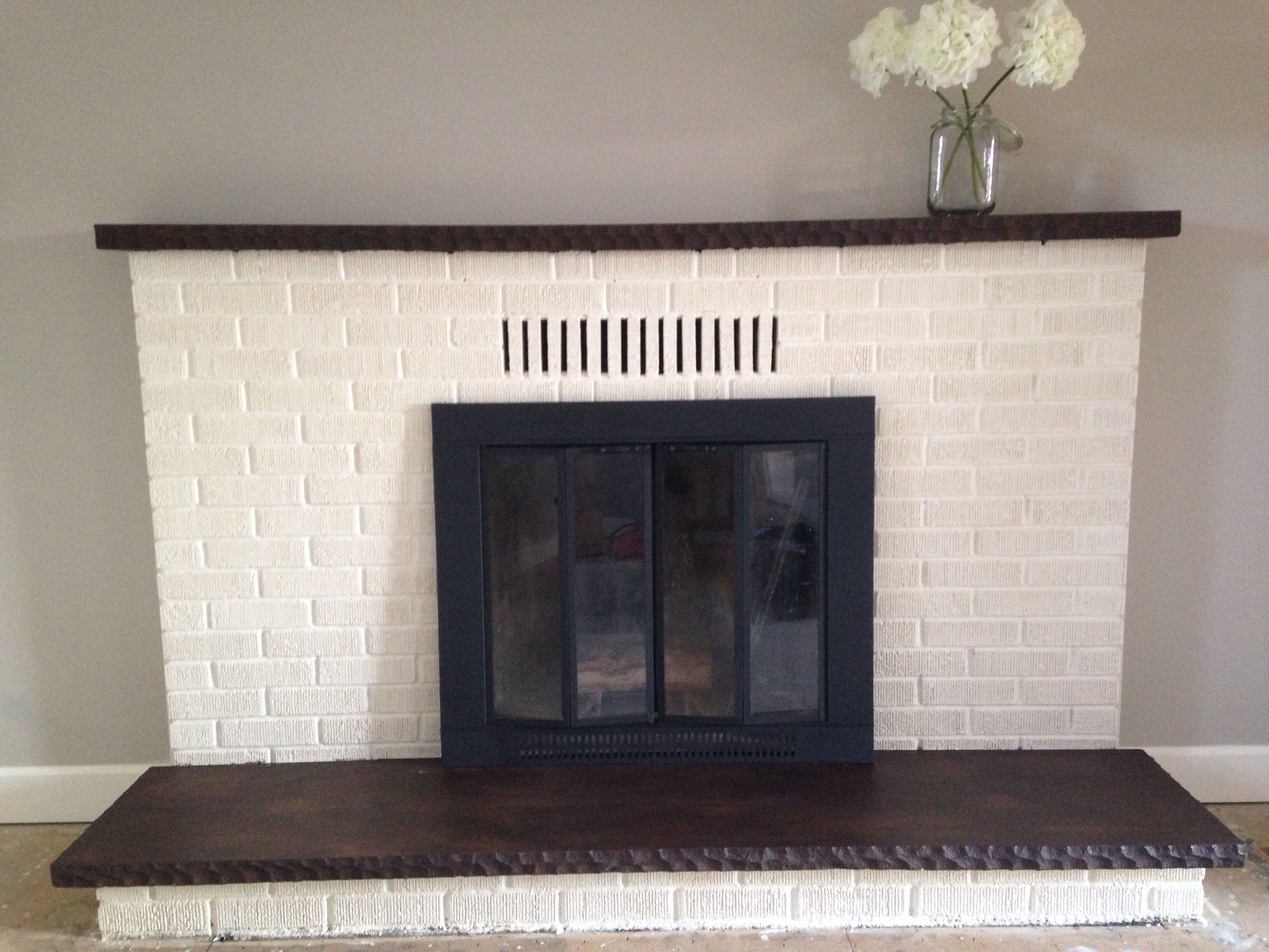 updated fireplace old white chalk paint on the brick and walnut