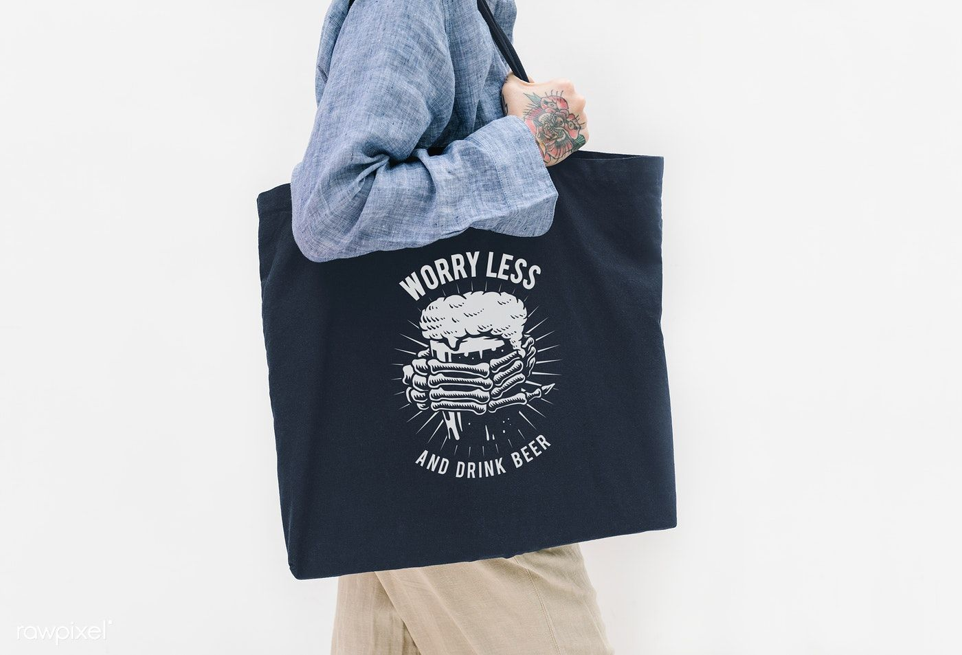 Download Download Premium Psd Of Tattooed Woman In A Blue Linen Shirt Holding A Black Tote Bag Linen Shirt Blue Linens
