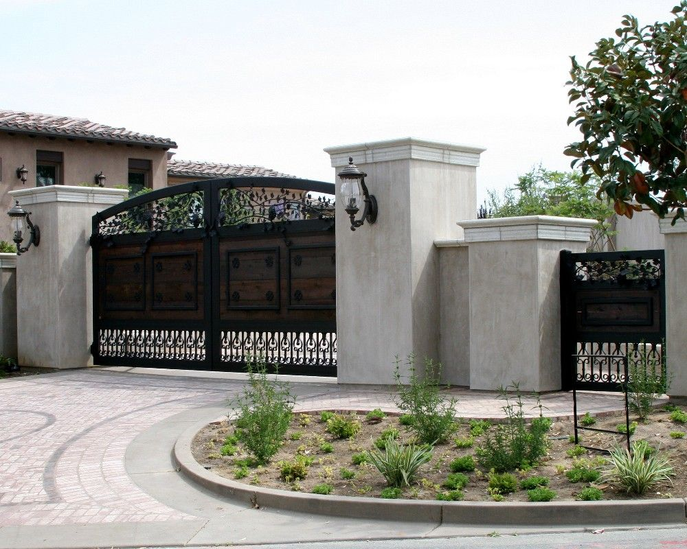 A wood and iron gate located in Temecula, CA. Designed, built and installed by Rising Star Industries. We are southern Californias leading automatic gate installers. Automatic gates in southern California. Driveway gates, security gates, electric gates, wrought iron gates, property security, swing gates, slide gates & vertical lift gates. We also do masonry columns, custom wrought iron front doors and window coverings. www.rsigate.com or www.risingstarindustries.com