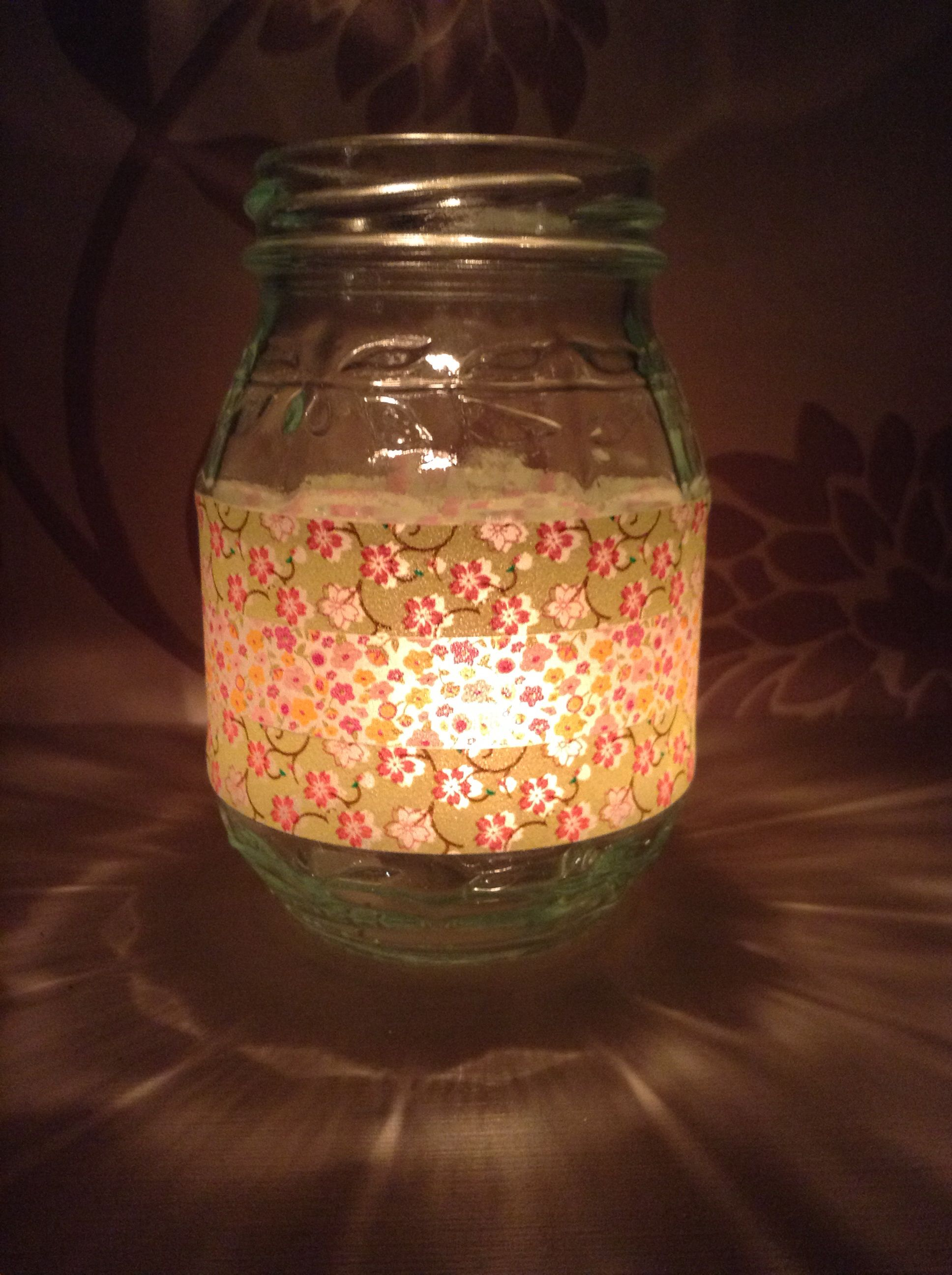 Washi tape and jam jars make super candle holders. Would look lovely ...