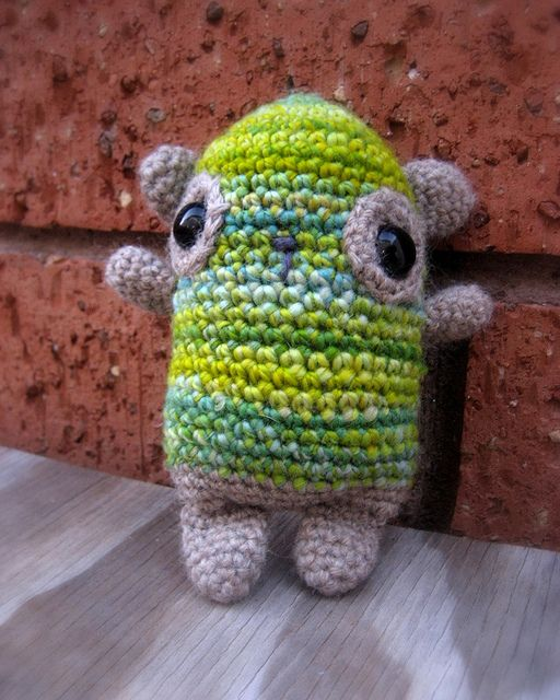 Normal panda pattern from Ravelry turned into a little zombie/monster with the green colors.