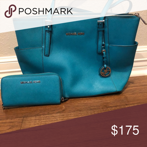 0a04ef15e3ec Michael Kors Purse and matching Wallet very gently used beautiful blue Michael  Kors purse and matching wallet. I am selling a lot of my purses that I no  ...