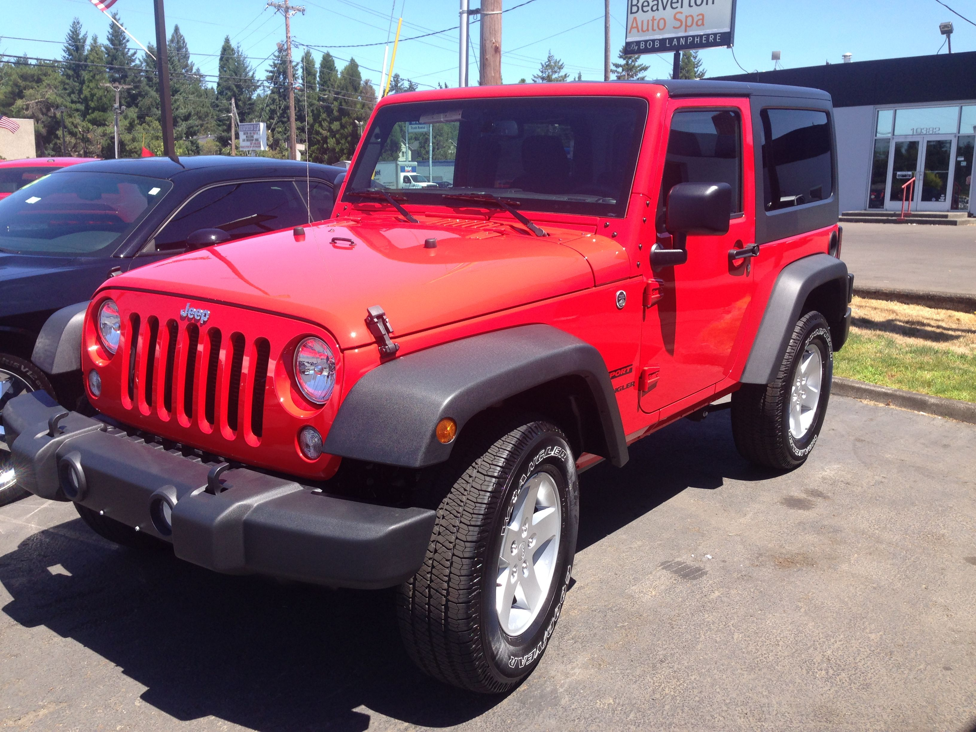 2015 Red Jeep Wrangler Sport... Yep. Right there. This is