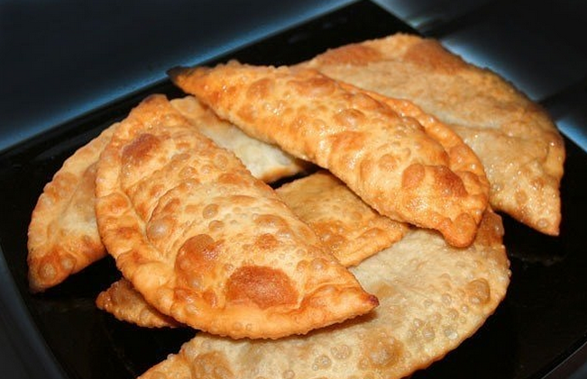 Pasties with mushrooms and cheese.