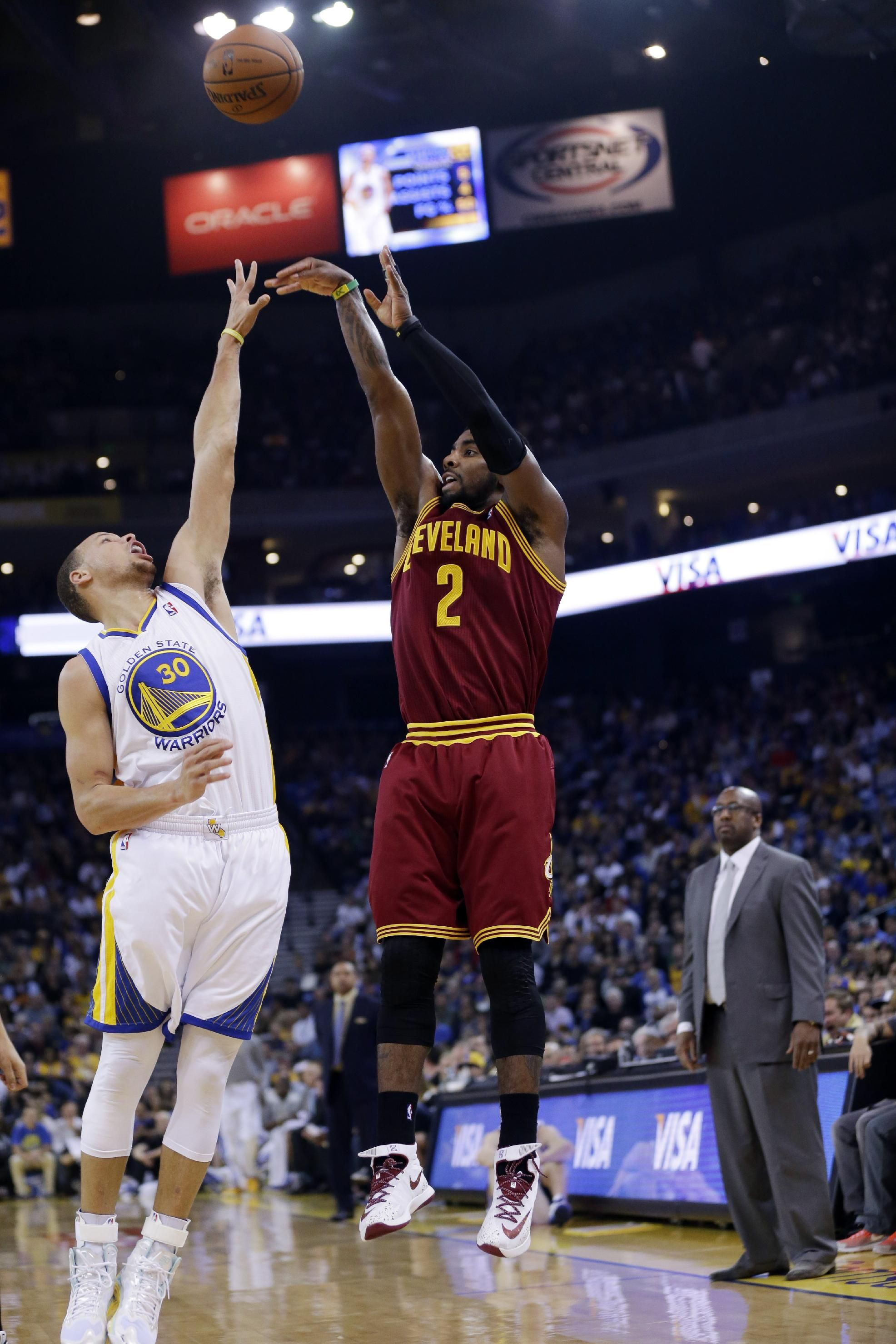 2188a60620fd Cleveland Cavaliers guard Kyrie Irving (2) shoots over Golden State  Warriors guard Stephen Curry (30) during the first half of an NBA basketball  game on ...