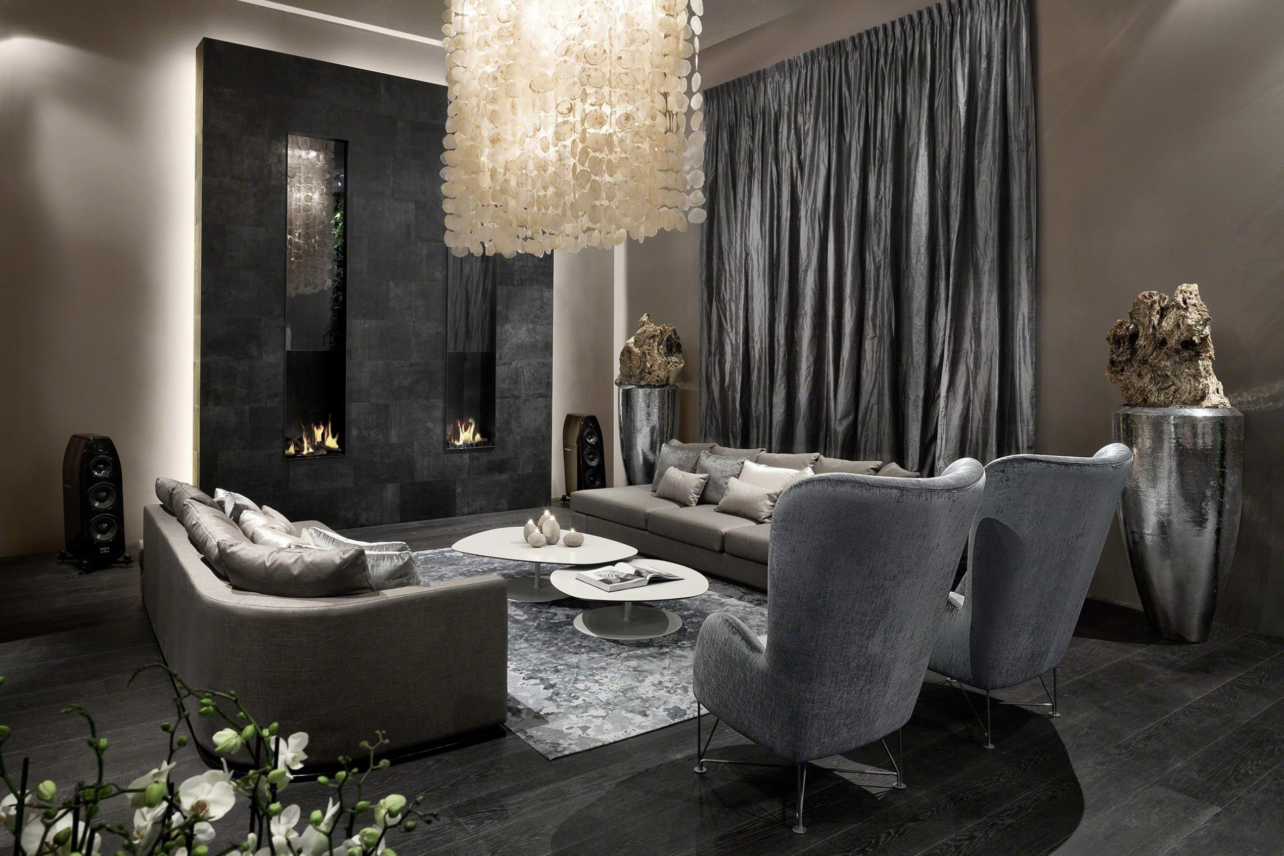 Elegance small modern living room interior using unique paper hanging lamp also grey sofa plus black concrete wall fireplace luxurious interior decor for