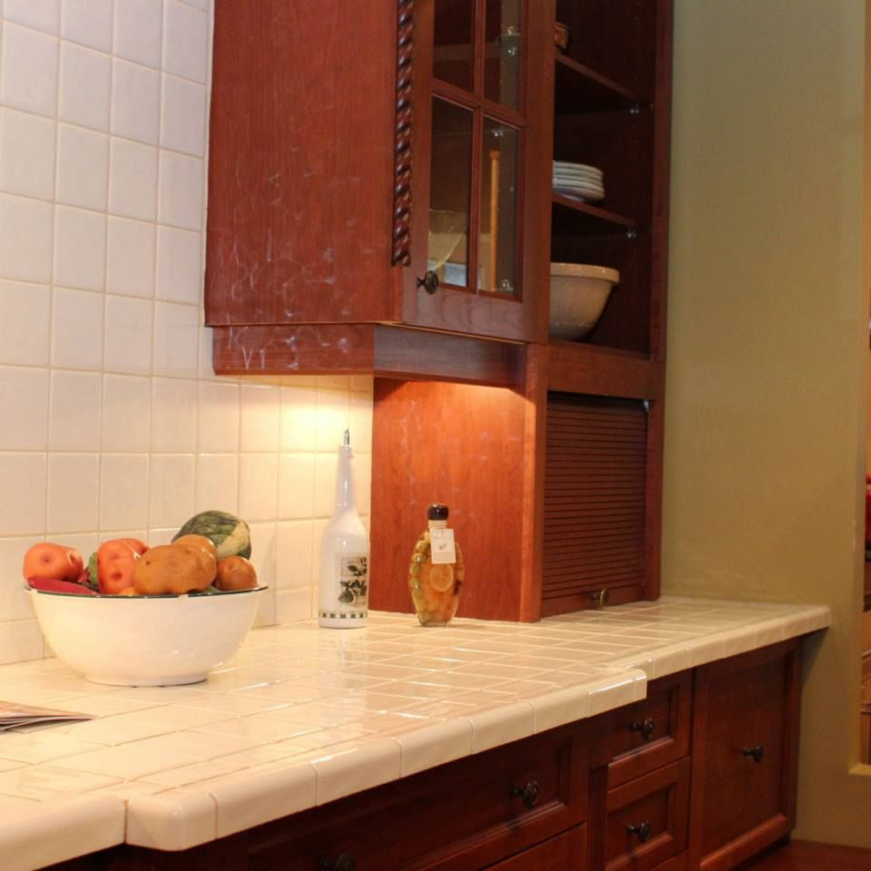Traditional counter and cabinet with appliance garage and ...