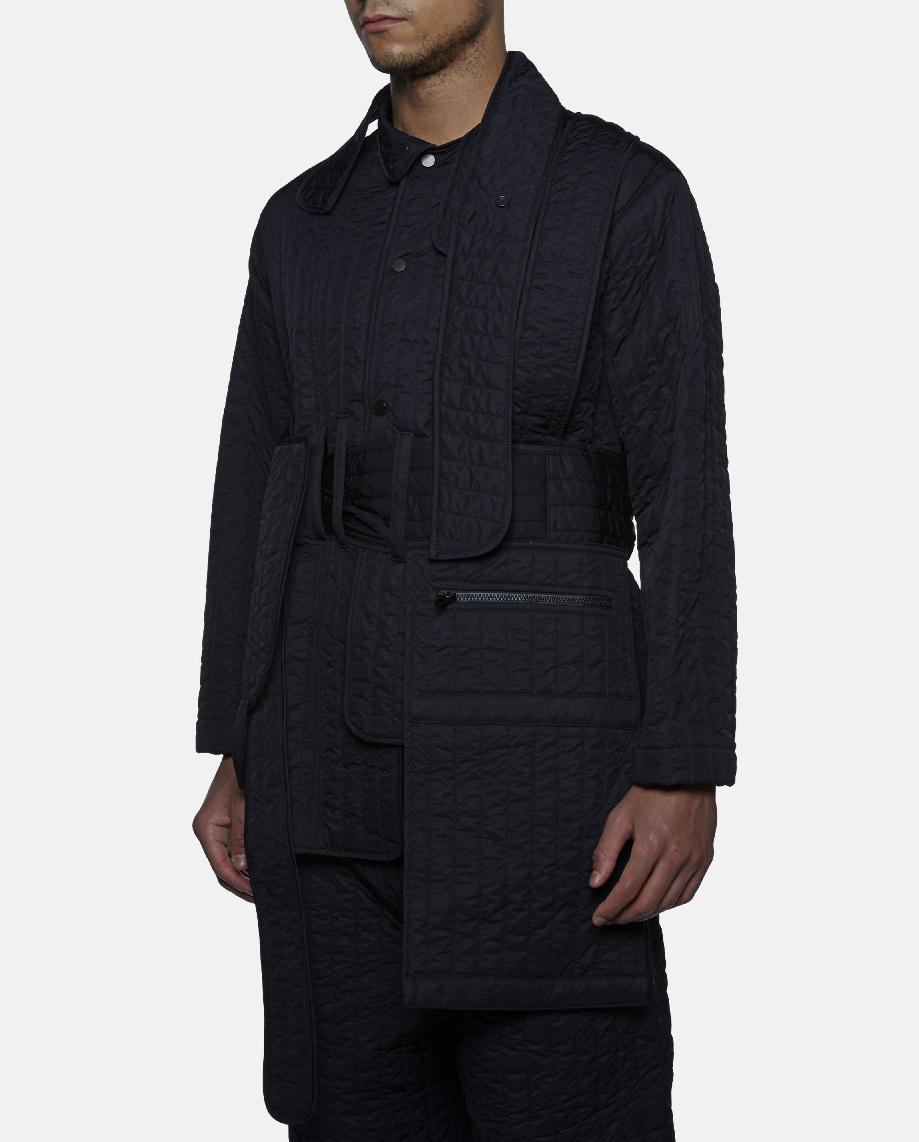 Quilted Black Jacket By Craig Green Featuring A Wrap Around Tie Belt Button Down Fastening And Oversized Pockets Mens Fashion Online Clothes Jackets