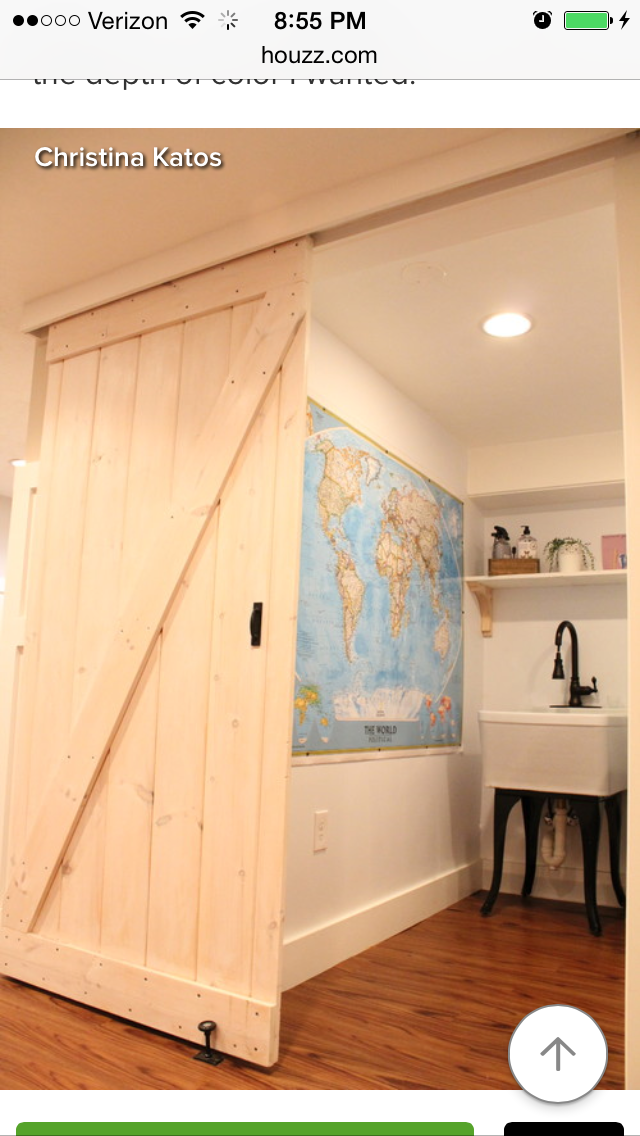 Diy Barn Doors You Can Afford Hung With Regular Closet Track And Hidden Behind A Wood Cornice She Also Uses Barn Door Building A Barn Door Indoor Barn Doors