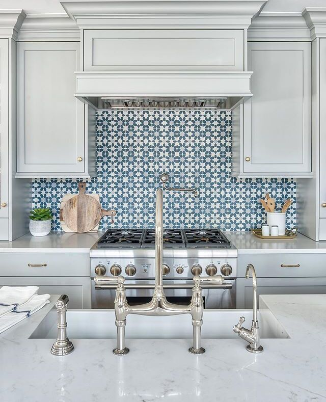 The Rohl Perrin Rohl Bridge Kitchen Faucet Reflects