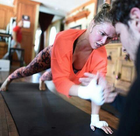 Ronda Rousey Doing Abdominal Work With Training Partner Ronda