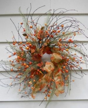 Fall twig wreath with berries by flora