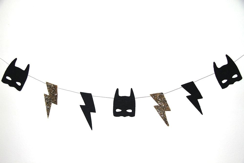 WHAM! POW! BAM! This ultra cool Batman Bolt Garland will add some serious style to any little ones room. Perfect for that little super hero in your life.Made with stiffened black felt and glitter material and hung on a clear line. Approximately 1.3m long.Comes in two colour choices. Black sparkle or goldPREORDER:  Due to Arrive End of Feb