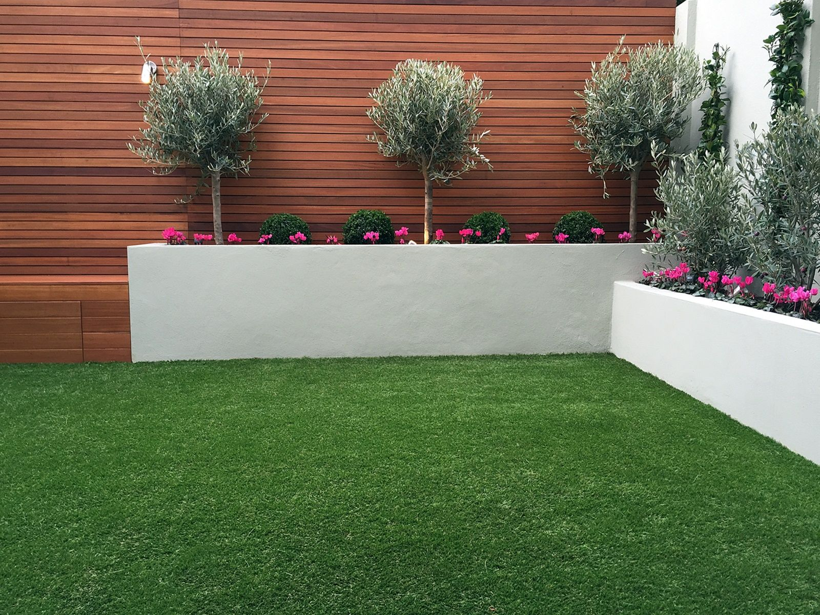 Raised grey beds topiary hardwood horizontal privacy screen fake