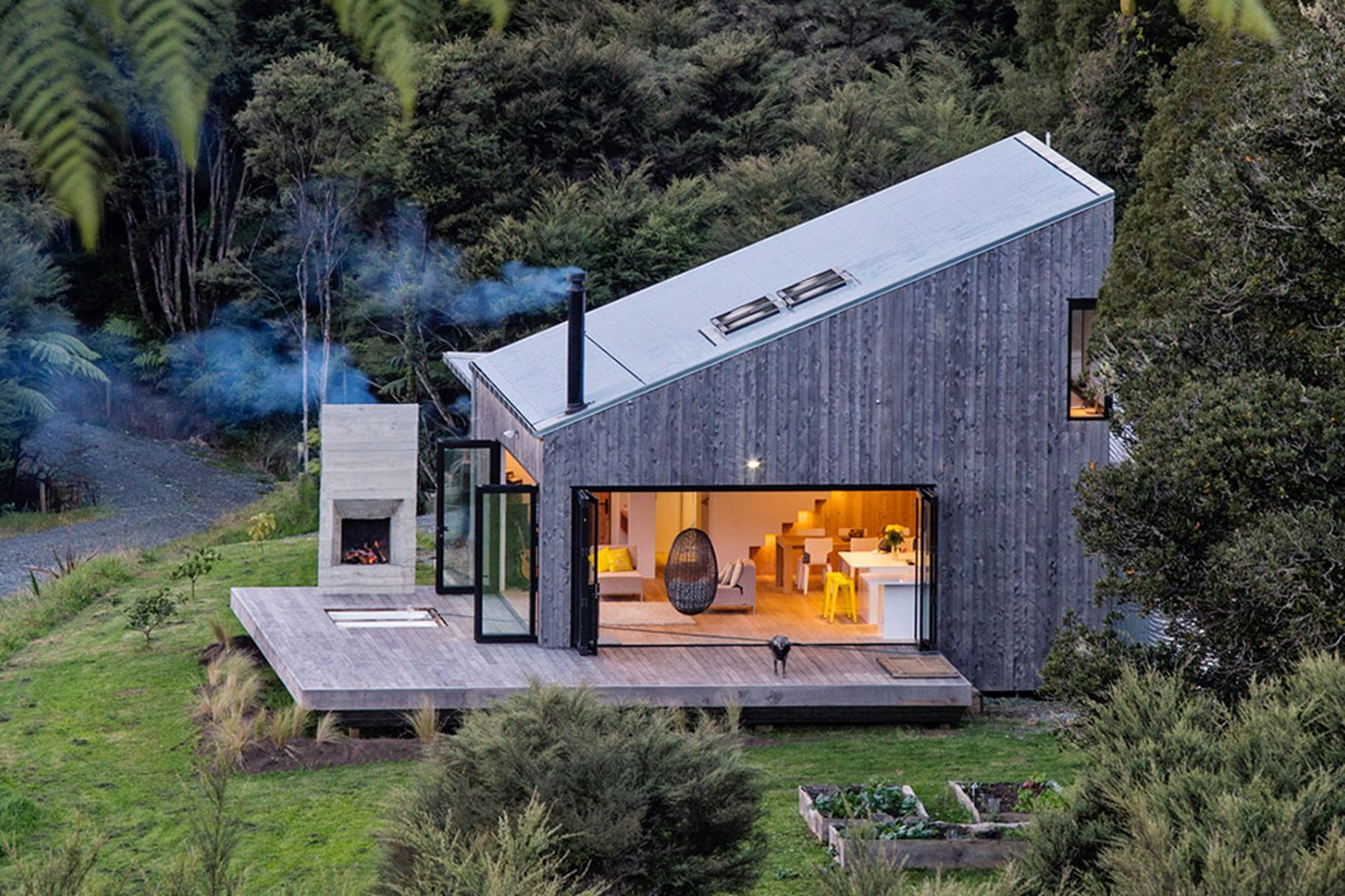 New Zealand S Backcountry Huts Inspired This Breezy Open Home Architecture Container House House Exterior