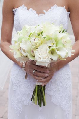 I like BIG all white bouquets with a hint of green and purple