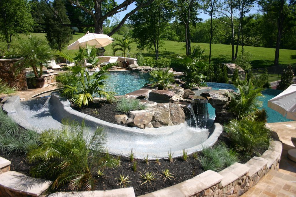 Tropical Swimming Pool With Fence Raised Beds Exterior Stone Floors Pathway Exterior Tile Floors Pool With Hot T Luxury Swimming Pools Swimming Pools Pool
