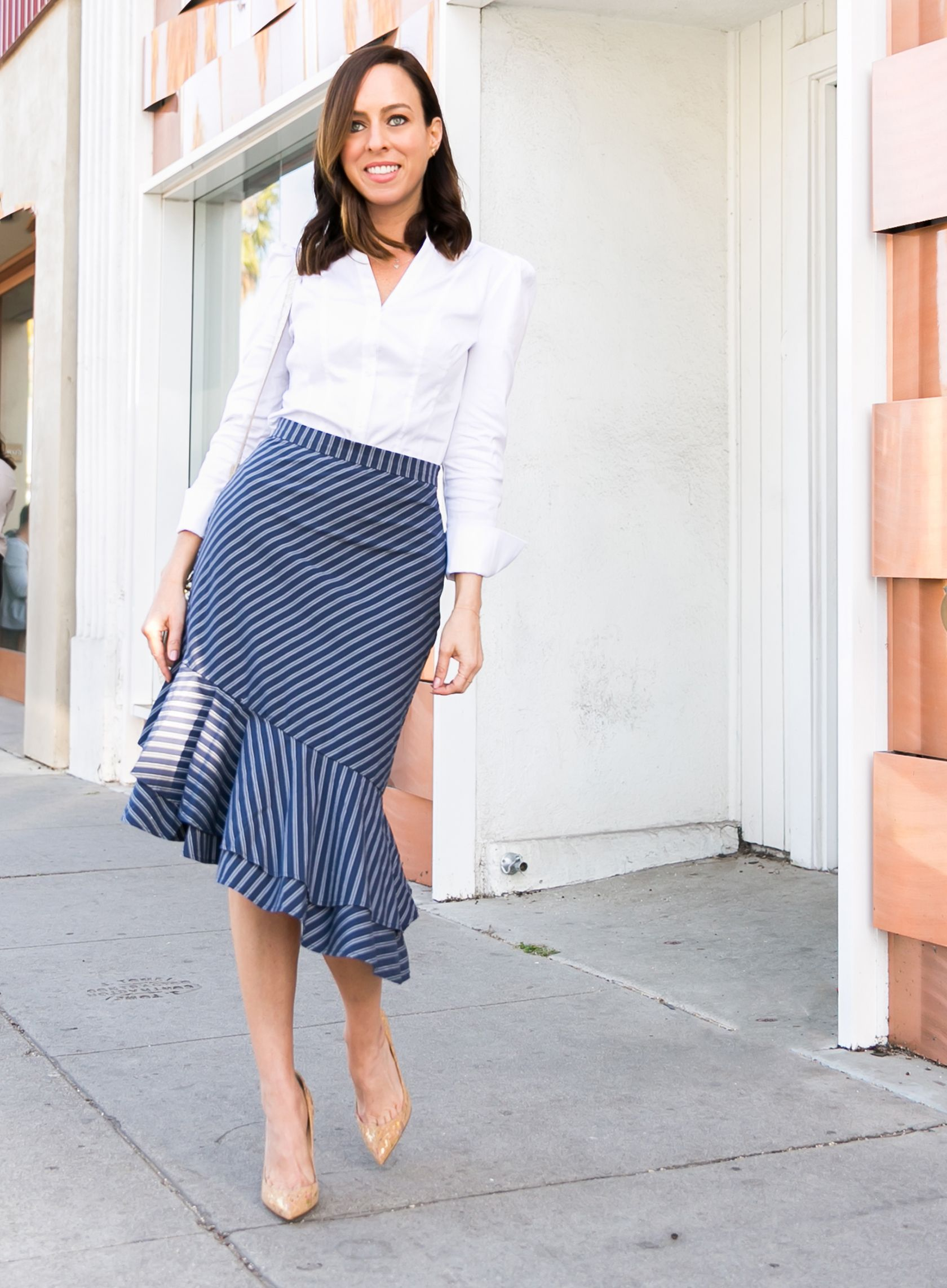 b86e690a23 Sydne Style shows office outfit ideas in white button down shirt and joie  stripe skirt #stripe #skirts #prints #ruffles #louboutin