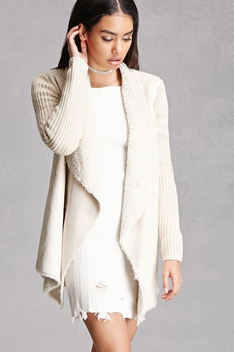 A longline cardigan featuring a faux fur-trimmed collar, and ...