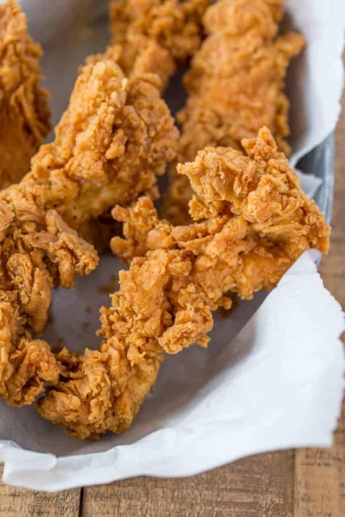 Crispy Chicken Tenders Marinaded In Buttermilk Then Fried Or Oven Baked Golden Brown Are Crispy Chicken Tenders Fried Chicken Tenders Chicken Tenders Dinner