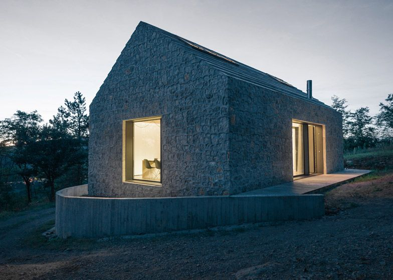 Modern Stone Cottage rural slovenian cottage featuring walls of stone set into concrete