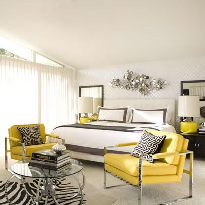 White bedroom with grey and yellow accents