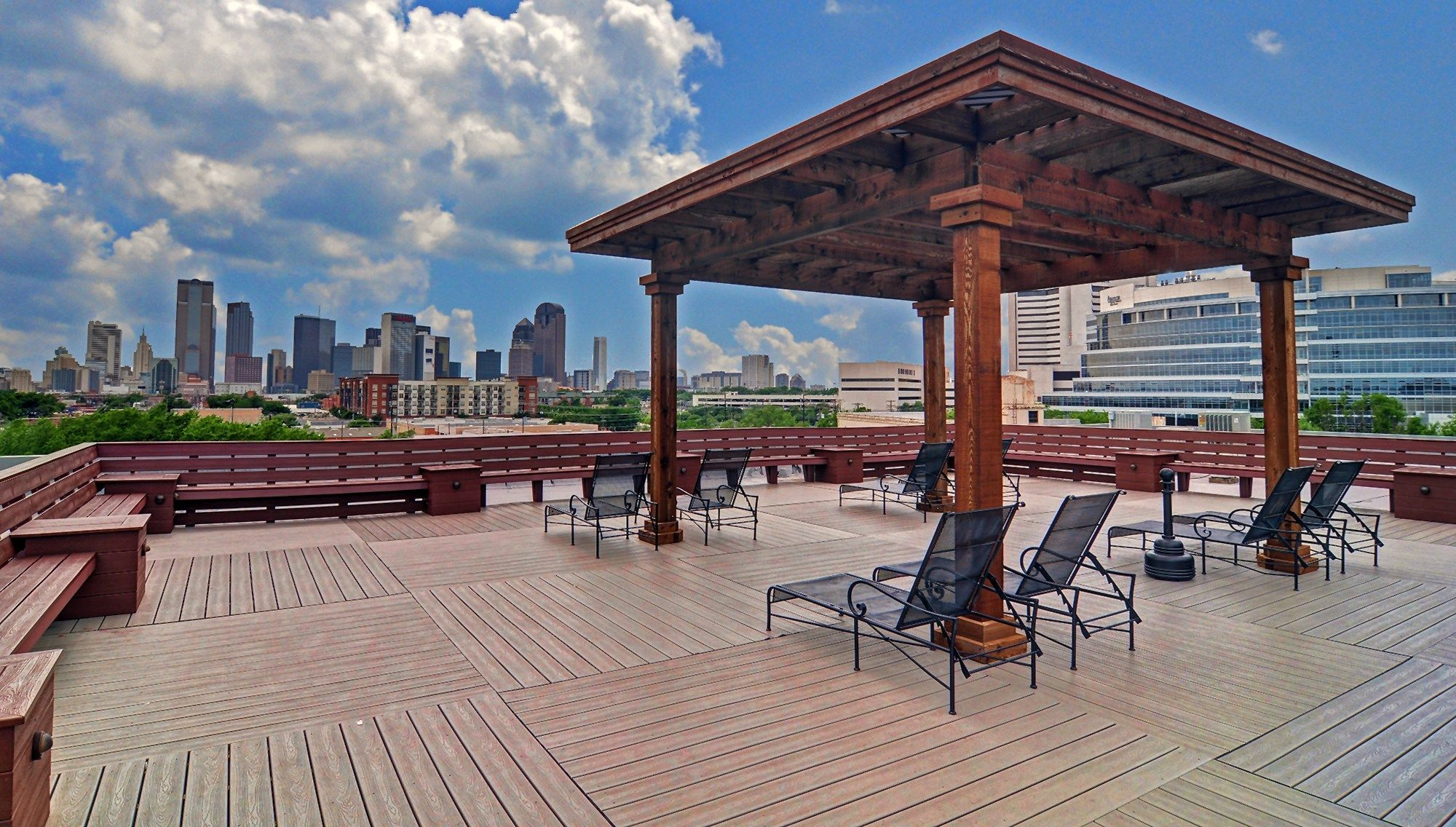 Relaxing Day And Enjoying The View At Deep Ellum Lofts Rooftop Patio In  Dallas, TX