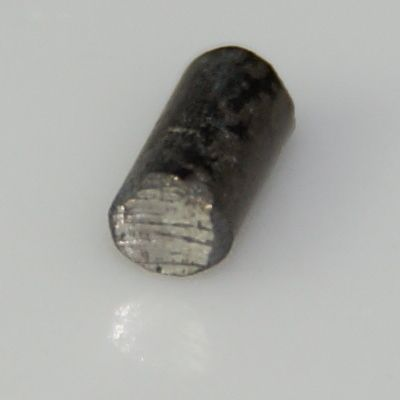 Used flintstone from a lighter, made of ferrocerium (cerium and iron)