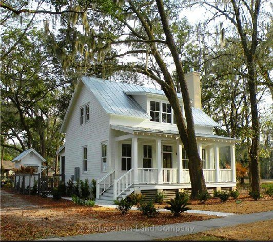 Love the dormer, the porch and the tin roof.