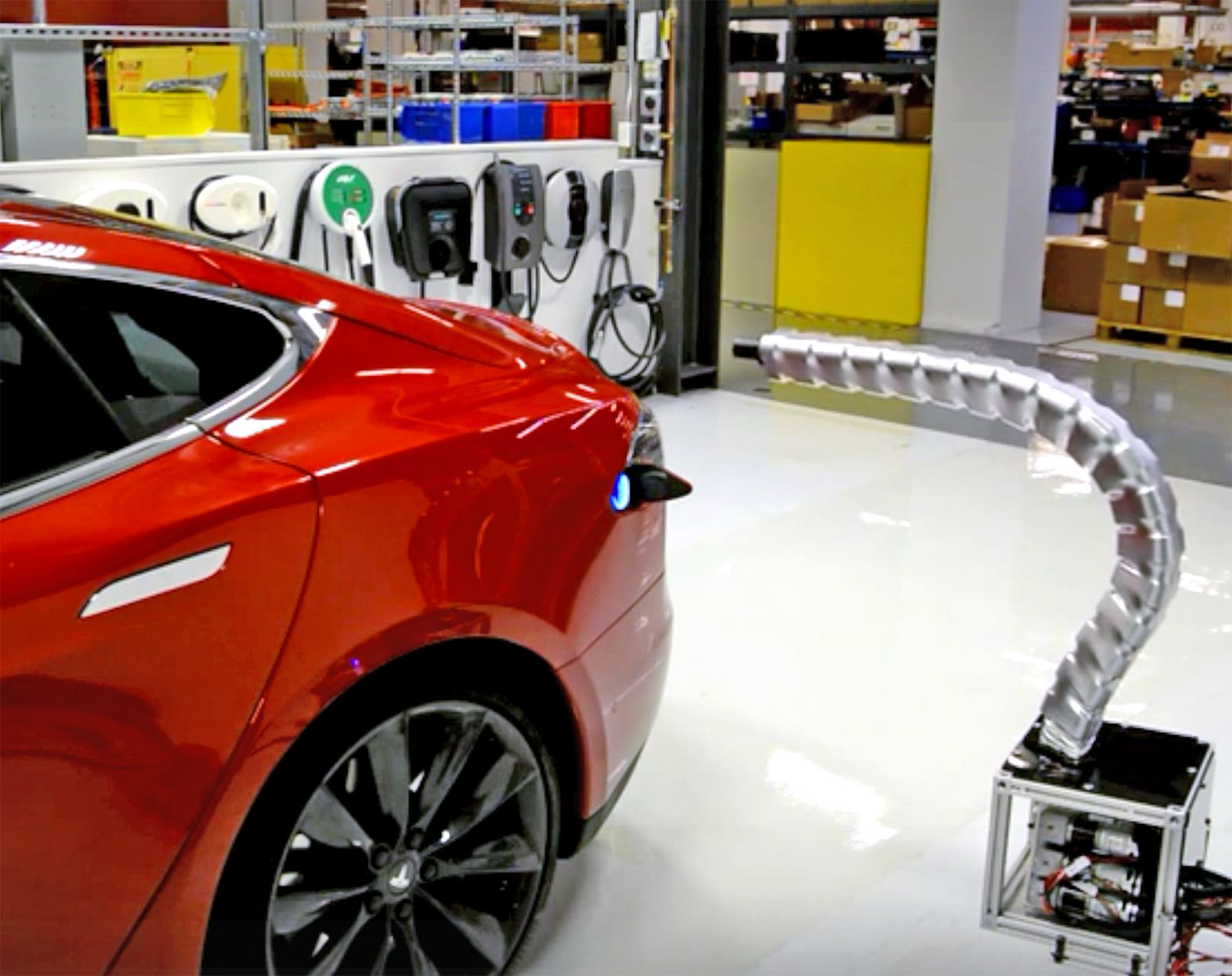 Tesla unveils futuristic robotic snake charger for electric vehicles